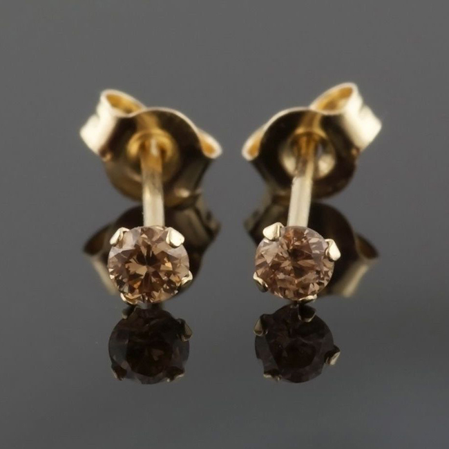 .25 carat of natural chocolate brown diamond stud earrings. These Beautiful diamonds are set in 14K or 18K white gold and are for sale